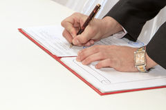 Business worker signing the contract Stock Photos