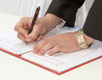 Business worker signing the contract Stock Photo