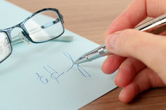 Business worker signing the contract to conclude a deal Royalty Free Stock Image