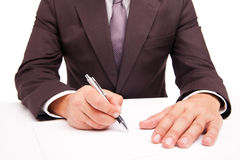 Business worker signing the contract on white Royalty Free Stock Image
