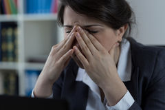 Business worker with sinus pain royalty free stock image