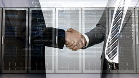 Business workers shaking hand with server tower overlay stock footage