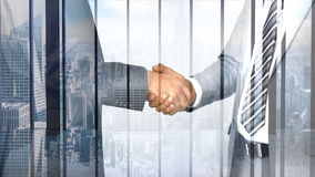 Business workers shaking hand with skyscraper overlay stock footage