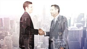 Business workers shaking hand with skyscraper overlay stock video footage