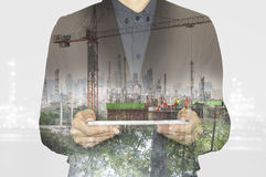 Business working on tablet.Green nature environment tecnology factory industry to concept. Urban city lifestyle. Double exposure layers multiplys business stock photography