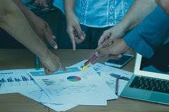 Business working team pointing the sale report. For analysis Royalty Free Stock Image