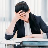 Business workload inefficient work tired woman. Pressure of business. heavy workload. inefficient time management. bad work planning. overworked tired woman Royalty Free Stock Photos