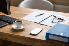 Business workplace with documents and espresso. Business workplace background with computer, documents and cup of espresso Royalty Free Stock Photography