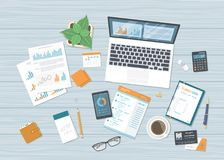 Business workplace with forms charts, graphs, laptop with information on the screen, notebook, phone, planner. Accounting analysis. Research planning audit Royalty Free Stock Images