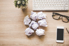 Business workplace with keyboard mouse and crumpled paper balls ,papers with graphs and diagrams . Business Concept stock photos
