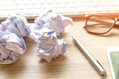 Business workplace with keyboard mouse and crumpled paper balls ,papers with graphs and diagrams . Business Concept royalty free stock photos