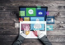 Business workplace with laptop in female hands device and media Stock Image