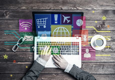 Business workplace with laptop in female hands device and media Royalty Free Stock Image