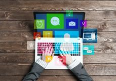 Business workplace with laptop in female hands device and media user interface Stock Photos