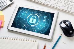 Web security and technology concept with tablet pc on wooden table Royalty Free Stock Photo