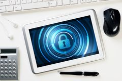 Web security and technology concept with tablet pc on wooden table Stock Photos