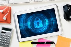 Web security and technology concept with tablet pc on wooden table Stock Images