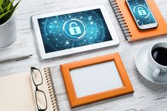 Web security and technology concept with tablet pc on wooden table Royalty Free Stock Photos