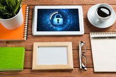 Web security and technology concept with tablet pc on wooden table Royalty Free Stock Images