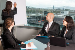 Business and workshop. Workshop with four persons in a panorama office Royalty Free Stock Photography