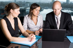 Business and workshop. Three persons in a panorama office stock images
