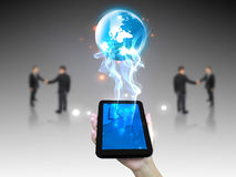 Business world. On tablet pc Royalty Free Stock Image