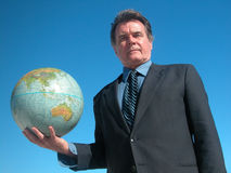 Business World. Businessman holding a globe stock photo