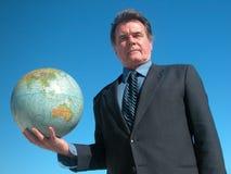 Business World. Businessman holding a globe Stock Photo
