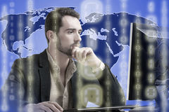 Business World. Businessman on top of a world map surrounded by binary code royalty free stock image