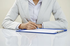 Business writing on documents Royalty Free Stock Photos