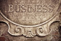 Business written on stucco wall Royalty Free Stock Images