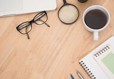 Business's desk of office supplies and gadgets coffee cup, pen, Royalty Free Stock Photos