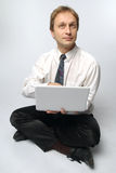 Business Yoga!. Young businessman yoga before an open notebook Stock Photography