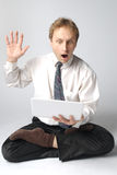 Business Yoga!. Young businessman yoga before an open notebook Stock Photos