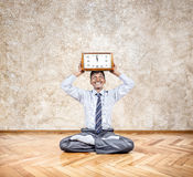 Business yoga with clock Stock Photo