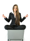 Business Yoga. Business woman meditating in front of a laptop Stock Photos