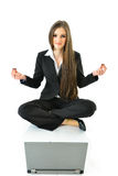 Business Yoga. Business woman meditating in front of a laptop Royalty Free Stock Photos