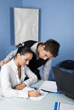 Business  young adults working in office Stock Images