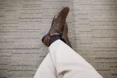 business young man relaxing chilling with legs crossed on carpet Royalty Free Stock Images
