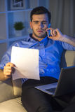 Business. Young man is working with laptop at home Stock Images