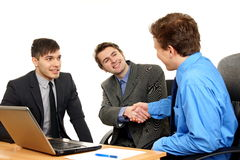Business young people shaking hands Stock Photos