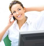 Business young woman. With a computer and phone Royalty Free Stock Photos