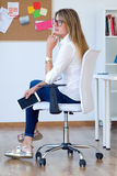 Business young woman relaxing one moment in her office. Royalty Free Stock Images