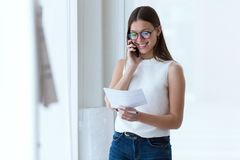 Business young woman using her mobile phone in the office. Stock Images