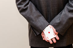 Businessamen with aces in the sleeve Royalty Free Stock Photo
