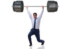 Businessan onder de last van hoge belasting en schuld stock foto's