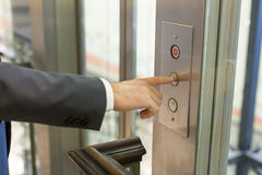 Businessan pressing elevator button Stock Photography