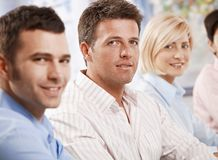 Businessan smiling at camera in meeting. Royalty Free Stock Photography