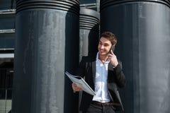 Businessan talking outdoors stock photos