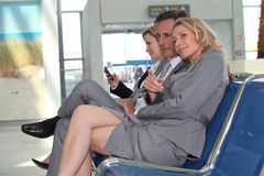 Businesscouple in departure lounge Stock Photo